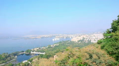 Panoramic view of the Indian city of Udaipur out of moving cableway wagon. Stock Footage