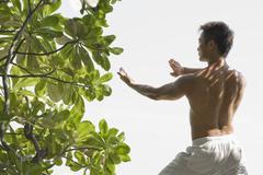 Man Practicing Martial Arts Stock Photos