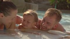 Happy family have a fun in the swimming pool together Stock Footage
