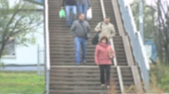 Slow motion unknown people down the stairs not in focus Stock Footage