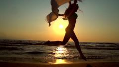 Stock Video Footage of Beauty summer model girl in bikini dancing on the beach
