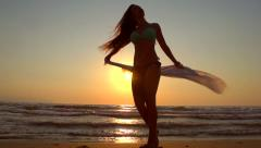 Beauty summer model girl in bikini dancing on the beach - stock footage