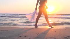Summer model girl going for a walk along coastline Stock Footage