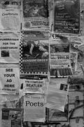 Black and white of old advertisements posted to a wall - stock photo
