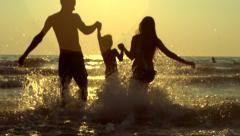 Happy family with a child at the beach Stock Footage