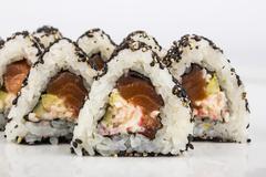 Triangular sushi with sesame seeds Stock Photos