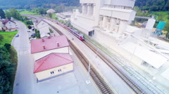 Train arrive on railway station aerial shot Stock Footage
