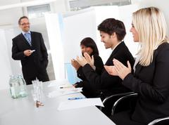 business people at presentation applauding - stock photo