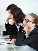 bored businesswoman sleeping in a meeting - stock photo