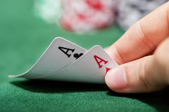 Poker player checking a pair of aces Stock Photos