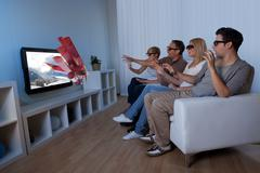 Family watching 3d television Kuvituskuvat