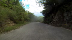 Vacationers explore the dirt roads of the USVI Stock Footage