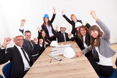 Stock Photo of portrait of engineers cheering