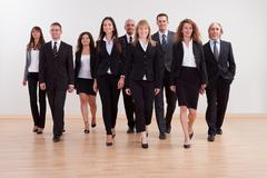 group of business executives approaching - stock photo
