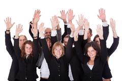 Group of business people waving in acknowledgemnt Stock Photos