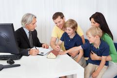 family in real-estate agency - stock photo