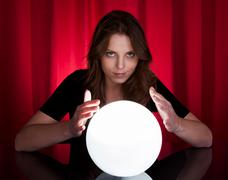 Fortuneteller with glowing ball Stock Photos