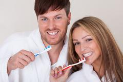 they brushed teeth together - stock photo