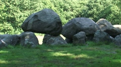 Two Prehistoric megalithic burial chambers or Dolmen (Hunebed) at Drouwen + pan - stock footage