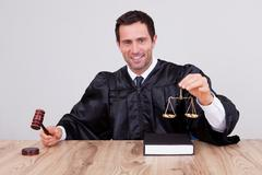 Male judge holding scale Stock Photos