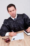 Male judge in courtroom Stock Photos