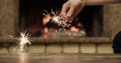 Sparkling bengal lights are burning in slow motion. Female hands holding Stock Footage