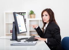 Businesswoman showing graph Stock Photos