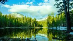 Time Lapse - Pond in the Forest with Snowy Mountain Peaks Stock Footage