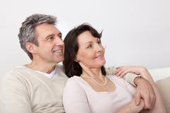 happy mature couple dreaming about the future - stock photo