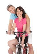 mature active couple doing sports - stock photo