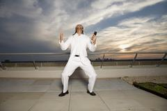 Man Screaming on Rooftop - stock photo