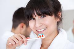 Young couple brushing teeth Stock Photos