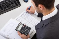 accountant working at the office - stock photo