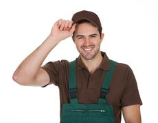 Happy young gardener in dungarees Stock Photos
