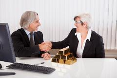 businesswoman with gold bullion bars - stock photo