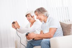 Middle-aged couple playing computer games Kuvituskuvat
