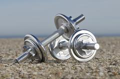 Dumbbells on Beach - stock photo