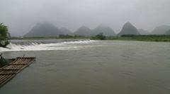 misty karst landform,Li river,bamboo rafts, - stock footage