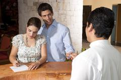 Couple Checking in to Hotel, Reef Playacar Resort and Spa, Playa del Carmen, Stock Photos