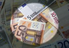 Spotlight on the euro currency Stock Photos