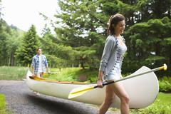 Stock Photo of Couple Carrying Canoe, Columbia River Gorge, Oregon, USA