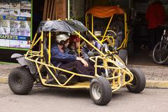 people in buggy in banos, ecuador - stock photo