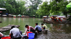 people washing by the bank at yangshuo - stock footage