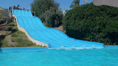 Riding on the water slides at Sicily Etnaland waterpark. Stock Footage