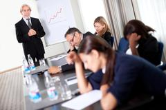 Businessman at a sales meeting discussing targets Stock Photos
