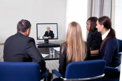 Businesspeople at a video conference Kuvituskuvat