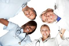 multi racial group or happy doctors smiling - stock photo