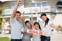 Happy family celebrating buying their new house Stock Photos