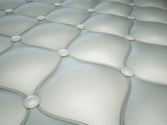 Stock Illustration of white stitched leather pattern with buttons and bumps