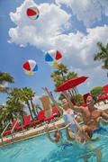 Family in Pool, PGA National Resort and Spa, Palm Beach Gardens, Florida, USA Kuvituskuvat